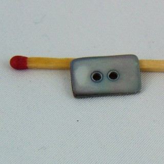Rectangular buttons in haberdashery 2 holes, 6 mm.