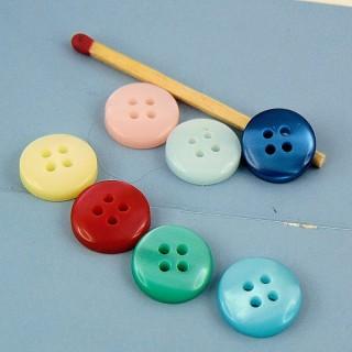 Botónes mercería redondo nacarado dos agujeros 1 cm.