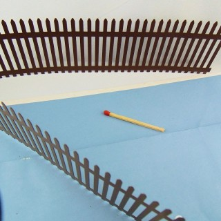 Miniature rusty picket fence for doll's house