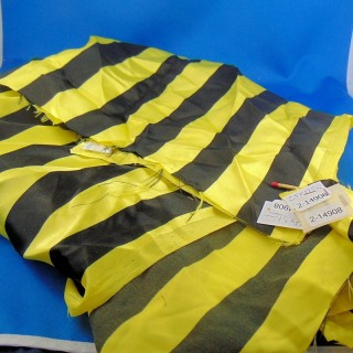 Synthetic coupon with large yellow and black stripes
